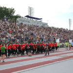 Athletes pass the grand stand